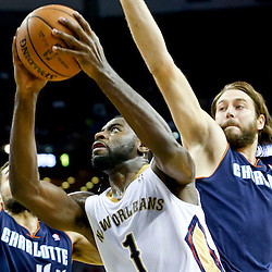 Nov 2, 2013; New Orleans, LA, USA; New Orleans Pelicans point guard Tyreke Evans (1) shoots over Charlotte Bobcats power forward Josh McRoberts (11) and shooting guard Jeffery Taylor (44) during the first half of a game at New Orleans Arena. Mandatory Credit: Derick E. Hingle-USA TODAY Sports