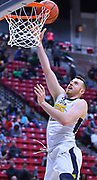SAN DIEGO, CA - MARCH 18:  West Virginia Mountaineers forward Maciej Bender (25) scores on a layup against the Marshall Thundering Herd during a second round game of the Men's NCAA Basketball Tournament at Viejas Arena in San Diego, California. West Virginia won 94-71.  (Photo by Sam Wasson)
