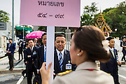 21 AUGUST 2014 - BANGKOK, THAILAND:  Lt-Gen PHISIT SITTHISARN, of the Royal Thai Army and a member of the National Legislative Assembly (NLA) waits with other members of the NLA for their group picture to be made before meeting to select a new Prime Minister. The Thai National Legislative Assembly (NLA) met Thursday at the Parlimanet Building in Bangkok to select a new Prime Minster. The NLA was hand selected by the Thai junta, formally called the National Council for Peace and Order (NCPO), and is supposed to guide Thailand back to civilian rule after a military coup overthrew the elected government in May. The NLA unanimously selected General Prayuth Chan-ocha, commander of the Thai Armed Forces and leader of the coup in May that deposed the elected civilian government, as Prime Minister. Prayuth is Thailand's 29th Prime Minister since the 1932 coup that created Thailand's constitutional monarchy.       PHOTO BY JACK KURTZ