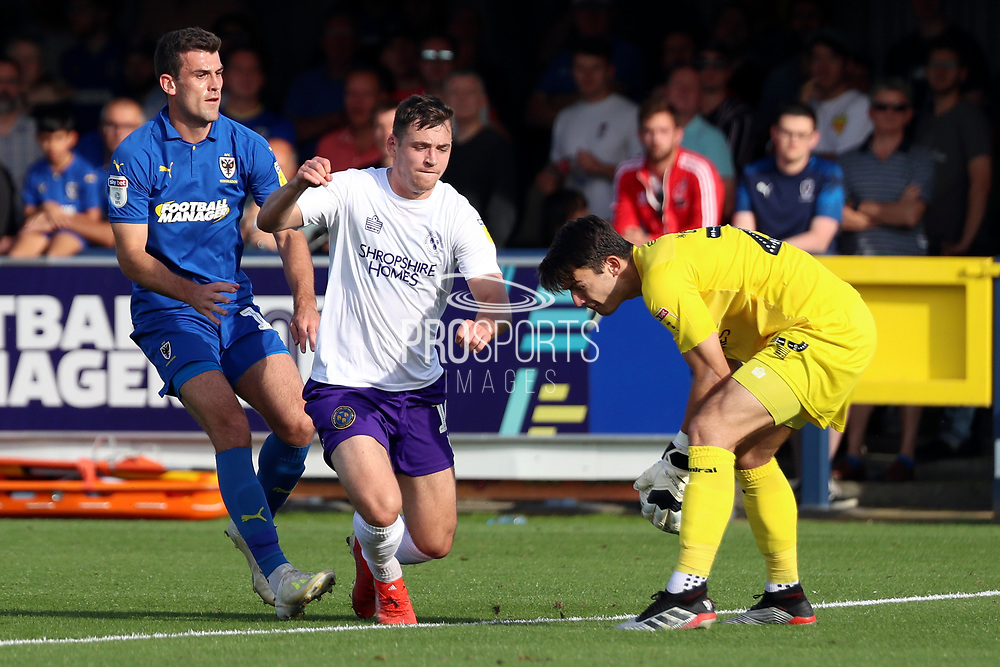 AFC Wimbledon attacker Adam Roscrow (10) chasing through ball during the EFL Sky Bet League 1 match between AFC Wimbledon and Shrewsbury Town at the Cherry Red Records Stadium, Kingston, England on 14 September 2019.