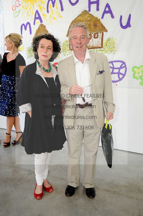 SIR RODDY & LADY LLEWELLYN at a charity lunch organised in aid of ASAP (African Solutions to African Problems) held at the Louise T Blouin Foundation, 3 Olaf Street, London W11 on 23rd June 2010.
