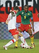 SZCZECIN 11/08/2010.FOOTBALL INTERNATIONAL FRIENDLY.POLAND v CAMEROON.SAMUEL ETO'O /CAM/ I MICHAL ZEWLAKOW /POL/.Fot: Piotr Hawalej / WROFOTO