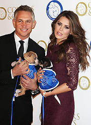 Gary and Danielle Lineker with two dogs at the Battersea Dogs & Cats Home Collars & Coats Gala Ball in London, Thursday, 7th November 2013. Picture by Stephen Lock / i-Images