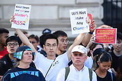 "© Licensed to London News Pictures. 17/08/2019. LONDON, UK.  Pro China demonstrators outside Downing Street take part in a counter protest against a solidarity rally for the people of Hong Kong.  Similar ""Global Solidarity with Hong Kong"" rallies are taking place worldwide as protests in the former British colony enter their tenth week demanding democratic reforms and a halt to police brutality.  Photo credit: Stephen Chung/LNP"