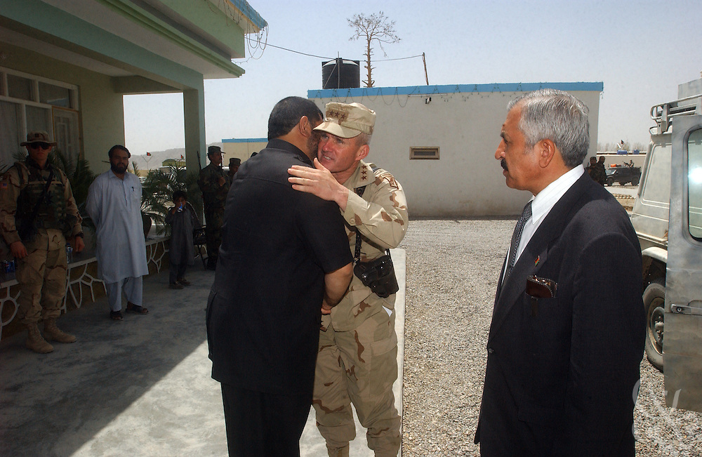 Kandahar regional governor Gul Agha Sherzai (l) greets Coalition Joint Task Force (CJTF) 180 U.S. Commander General Dan McNeill as he arrives at Sherzai's home for a meeting July 21, 2002 in Kandahar, Afghanistan. Sherzai had previously endorsed a plan that would require U.S. forces to seek permission of local authorities before launching military operations in the central and southern provinces of Afghanistan. Other local governors refused to back the plan, and after today's meeting with McNeill, Sherzai appears to have backed away from the idea.