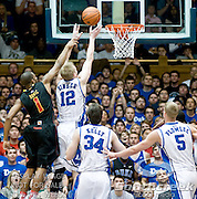 Duke Blue Devils forward Kyle Singler (12) goes up for a score over Maryland Terrapins guard Adrian Bowie (1). Duke beats Maryland 71-64 at Cameron Indoor Stadium
