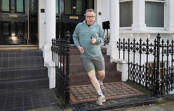 © Licensed to London News Pictures. 05/02/2018. London, UK. Environment Sectetary Michael Gove runs near his west London home. Later Brexit Secretary David Davis will meet with European Commission's Chief Negotiator Michel Barnier in Downing Street for talks. Photo credit: Peter Macdiarmid/LNP
