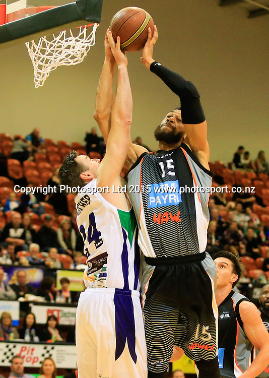 Hawk's Zachary Atkinson blocks a shot. NBL basketball, Hawkes Bay Hawks  v Super City Rangers, PG Arena, Napier, New Zealand. Saturday, 18 April, 2015. Copyright photo: John Cowpland / www.photosport.co.nz