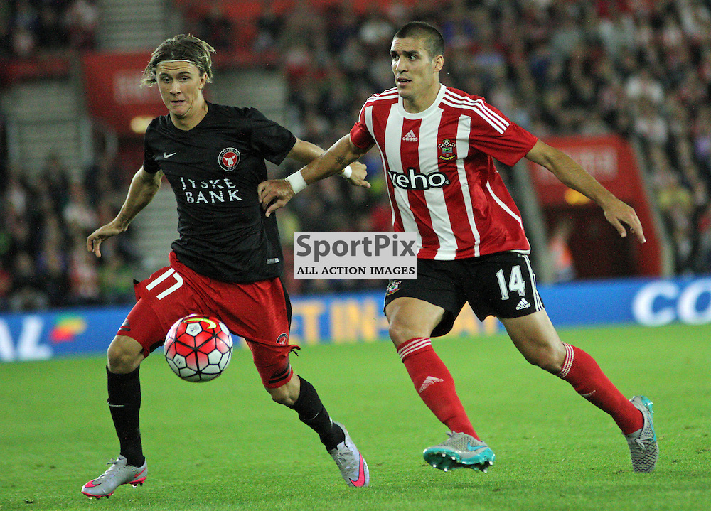 Kris Olsson battles with Oriol Romeu During Southampton FC vs Fc Midtjylland on Thursday the 20th August 2015.