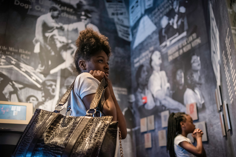 MONTGOMERY, AL -- 5/25/17 -- The Civil Rights Memorial Center is located in the former headquarters of the Southern Poverty Law Center. Dedicated to telling the story of the Civil Rights Movement, the museum sees 40,000 visitors a year. Amarie Williams, 12, left, and Destini Tucker, 8, read about Civil Rights history.<br /> Civil Rights attorney Morris Dees co-founded the Southern Poverty Law Center in 1971. The group has taken on the Ku Klux Klan and fought for against hate for decades, but is now facing criticism that it has labeled some groups without just cause..&hellip;by Andr&eacute; Chung #_AC17557