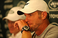 Brett Favre talks to the media during a press conference with New York Jets owner Woody Johnson and general manager Mike Tannenbaum  August 7, 2008 at Cleveland Browns Stadium