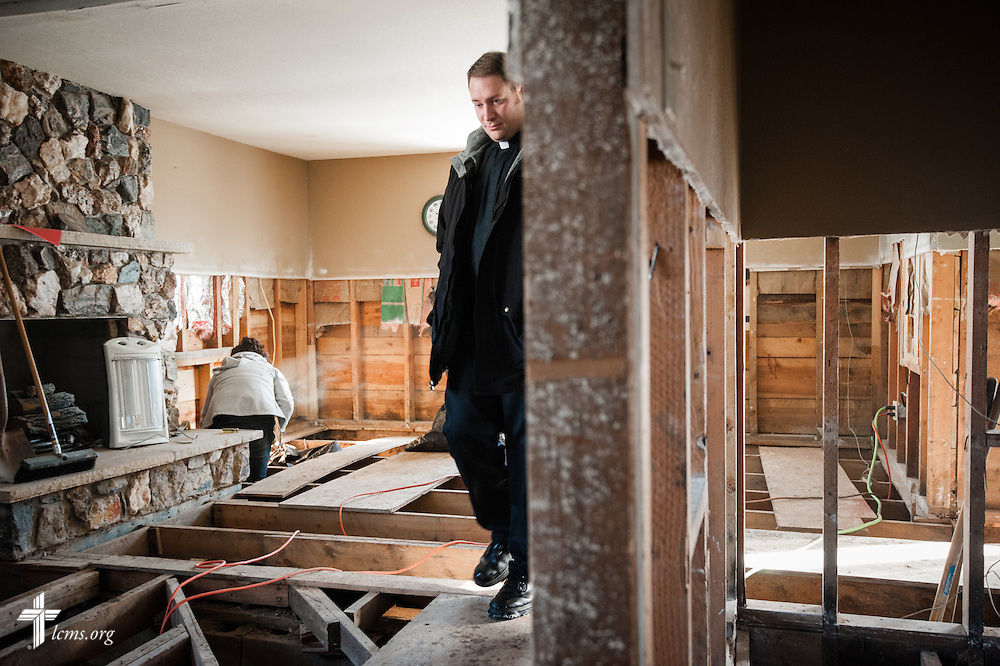 The Rev. Michael W. Meyer, manager of LCMS Disaster Response,  surveys a flood-damaged home in Lyons, Colo., on Wednesday, Jan. 8, 2014. LCMS Communications/Erik M. Lunsford
