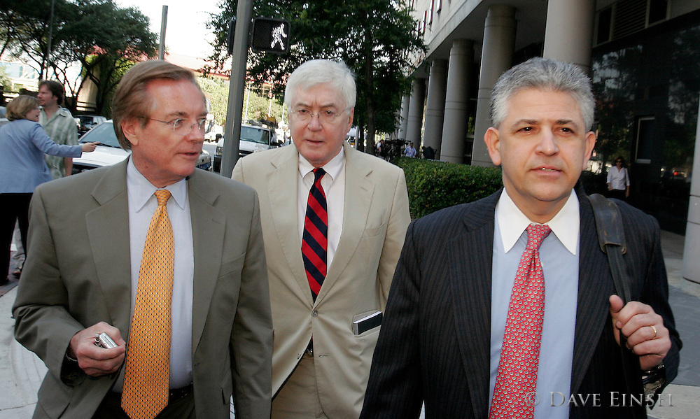 HOUSTON  - MAY 18: (L-R) Ron Woods, attorney for former Enron CEO Jeff Skilling, Mike Ramsey (L) lead attorney for former chairman Kenneth Lay and Daniel Petrocelli, lead attorney for Skilling, leave the Bob Casey U.S. Courthouse for lunch during their clients' fraud and conspiracy trial, May 18, 2006, in Houston. The jury continues to deliberate the defendants' guilt or innocence. (Photo by Dave Einsel)