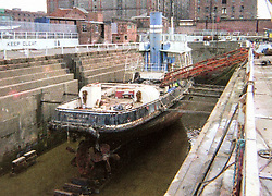 "© Licensed to London News Pictures. 04/05/2016. Birkenhead UK. Collect picture shows the Daniel Adamson looking in a sorry state at Clarence dry docks in 2004. The Daniel Adamson steam boat has been bought back to operational service after a £5M restoration. The coal fired steam tug is the last surviving steam powered tug built on the Mersey and is believed to be the oldest operational Mersey built ship in the world. The ""Danny"" (originally named the Ralph Brocklebank) was built at Camel Laird ship yard in Birkenhead & launched in 1903. She worked the canal's & carried passengers across the Mersey & during WW1 had a stint working for the Royal Navy in Liverpool. The ""Danny"" was refitted in the 30's in an art deco style. Withdrawn from service in 1984 by 2014 she was due for scrapping until Mersey tug skipper Dan Cross bought her for £1 and the campaign to save her was underway. Photo credit: Andrew McCaren/LNP ** More information available here http://tinyurl.com/jsucxaq **"