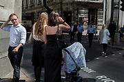 Londoners in sunshine during the 2018 heatwave in the City of London, the capital's historic financial district, on 2nd August 2018, in London, England.