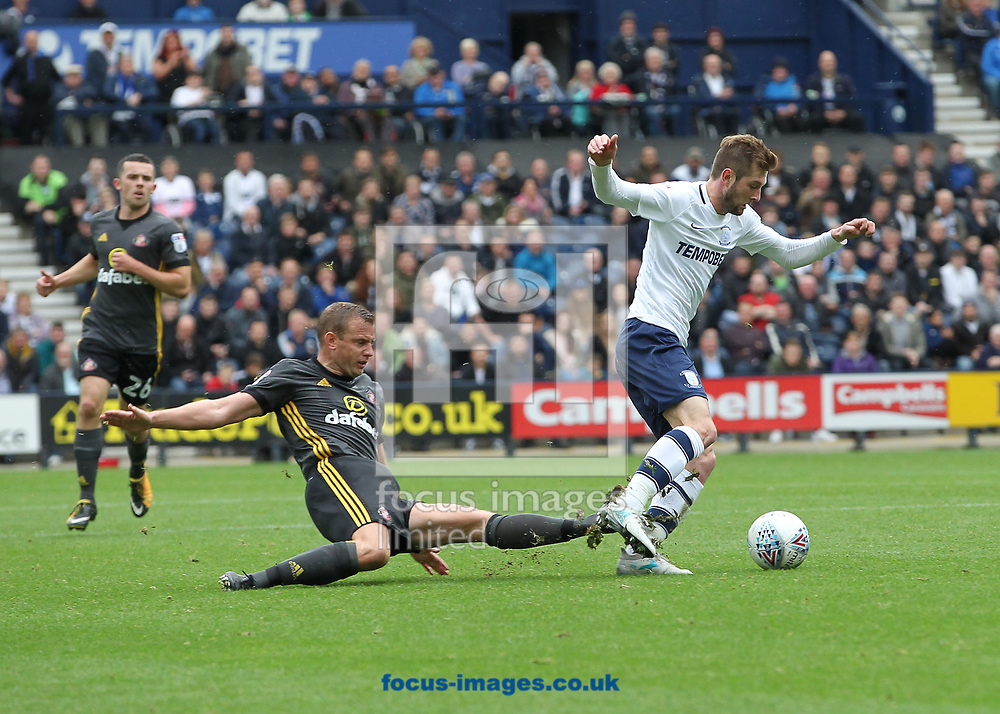 Tom Barkhuizen of Preston North End skips past a tackle by Lee Cattermole of Sunderland during the Sky Bet Championship match at Deepdale, Preston.<br /> Picture by Michael Sedgwick/Focus Images Ltd +44 7900 363072<br /> 30/09/2017