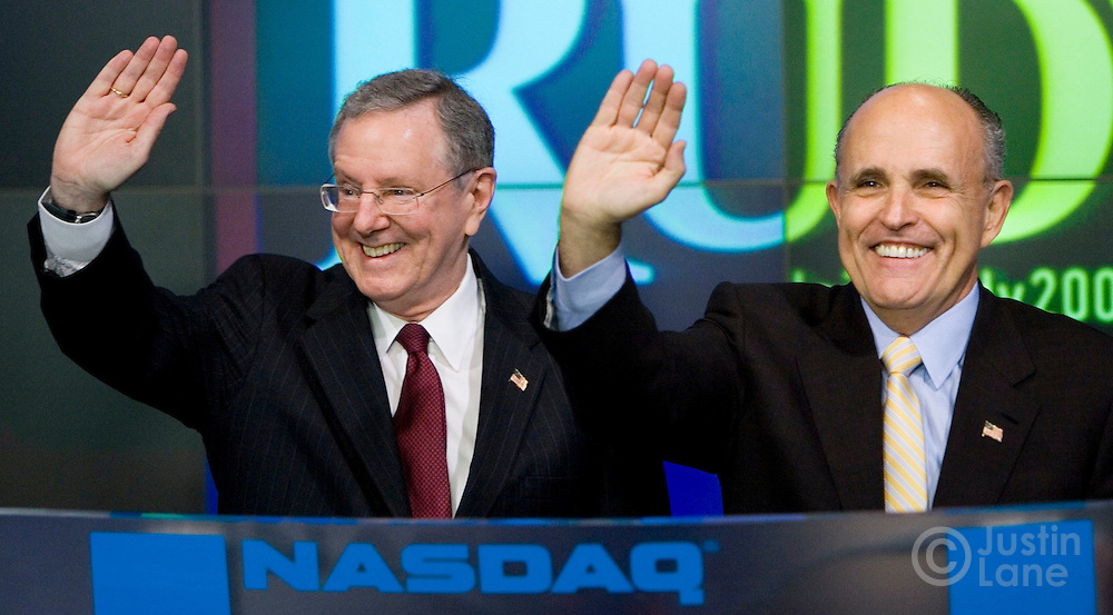US Presidential candidate Rudolph GiulianI (R) stands with Steve Forbes (L) while ringing the opening bell of the NASDAQ stock exchange in New York, New York on Wednesday 28 March 2007. Following the ringing of the bell, the two held a press conference where Steve Forbes announced that he was endorsing Giuliani's run to be President of the United States.