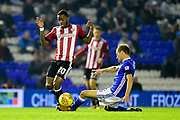 Brentford FC midfielder Josh Clarke (20) rides a tackle during the EFL Sky Bet Championship match between Birmingham City and Brentford at St Andrews, Birmingham, England on 1 November 2017. Photo by Dennis Goodwin.