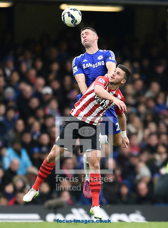 Gary Cahill of Chelsea and Dusan Tadic of Southampton during the Barclays Premier League match at Stamford Bridge, London<br /> Picture by Andrew Timms/Focus Images Ltd +44 7917 236526<br /> 15/03/2015