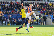 Luton Town's Cameron McGeehan and Oxford United's Liam Sercombe challenge for the ball during the Sky Bet League 2 match between Oxford United and Luton Town at the Kassam Stadium, Oxford, England on 16 April 2016. Photo by Shane Healey.