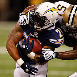 August 27, 2010; New Orleans, LA, USA; New Orleans Saints linebacker Jonathan Vilma (51) tackles San Diego Chargers running back Ryan Mathews (24) during the first quarter of a preseason game at the Louisiana Superdome. Mandatory Credit: Derick E. Hingle