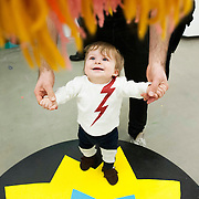 "March 10, 2012 - New York, NY :  With a helping hand from his father, Rob, one-year-old Pascal Spampinato plays beneath a hanging yarn puppet created by Misaki Kawai -- part of Kawai's installation ""Love from Mt. Pom Pom"" -- at the Children's Museum of the Arts in the south village on March 10. CREDIT: Karsten Moran for The New York Times"