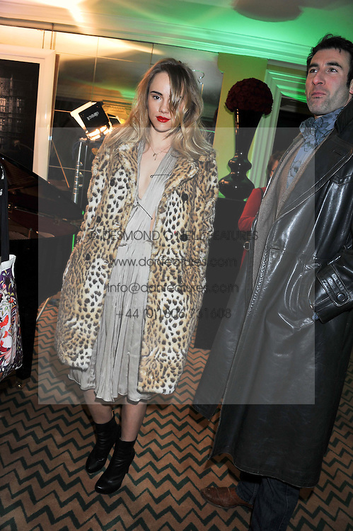 SUKI WATERHOUSE at the unveiling of the Claridge's Christmas tree 2011 designed by Alber Elbaz for Lanvin held at Claridge's, Brook Street, London on 5th December 2011.