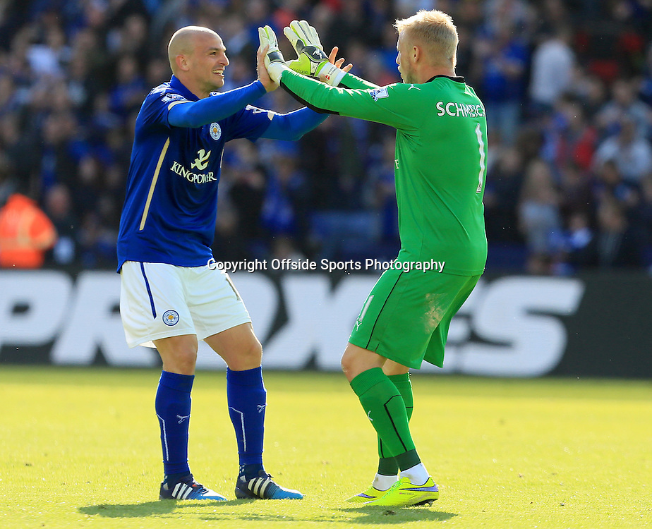 18th April 2015 - Barclays Premier League - Leicester City v Swansea - Kasper Schmeichel celebrates the final whistle with Esteban Cambiasso of Leicester City  - Photo: Paul Roberts / Offside.
