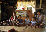 Fijian family in bure, Fiji
