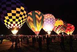 Hot air balloon fiesta crowds gather for the dawn patrol in Albuquerque