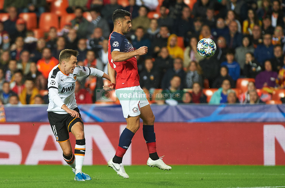 November 5, 2019, Valencia, Valencia, Spain: Denis Cheryshev of Valencia and Zeki Celik of Losc Lille during the during the UEFA Champions League group H match between Valencia CF and Losc Lille at Estadio de Mestalla on November 5, 2019 in Valencia, Spain (Credit Image: © AFP7 via ZUMA Wire)