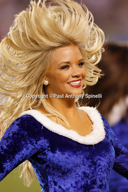 A San Diego Chargers cheerleader flips her hair as she smiles and cheers for her team during the NFL week 15 football game against the San Francisco 49ers on Thursday, December 16, 2010 in San Diego, California. The Chargers won the game 34-7. (©Paul Anthony Spinelli)