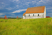 Grain elevators and old church in ghost town<br /> <br /> Neidpath<br /> Saskatchewan<br /> Canada