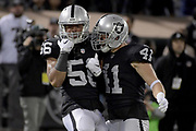 Dec 17, 2017; Oakland, CA, USA; Oakland Raiders linebacker Xavier Woodson-Luster (left) celebrates with Raiders defensive back Erik Harris (right) against the Dallas Cowboys during an NFL football game at Oakland-Alameda County Coliseum.