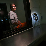 Missouri death row inmate Dennis Skillicorn sat in the visitors room behind glass on Thursday, May 14, 2009, at the Eastern Reception, Diagnostic and Correctional Center in Bonne Terre, Mo. Skillicorn was one of three men convicted of killing Richard Drummond in 1994 and is scheduled to be executed on Wednesday.
