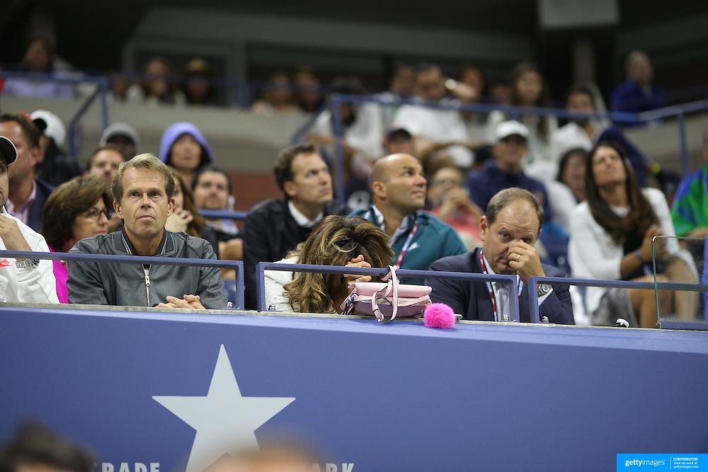 Mirka Federer and coach Stefan Edberg watching Roger Federer, Switzerland, in action against Novak Djokovic, Serbia, in the Men's Singles Final during the US Open Tennis Tournament, Flushing, New York, USA. 13th September 2015. Photo Tim Clayton