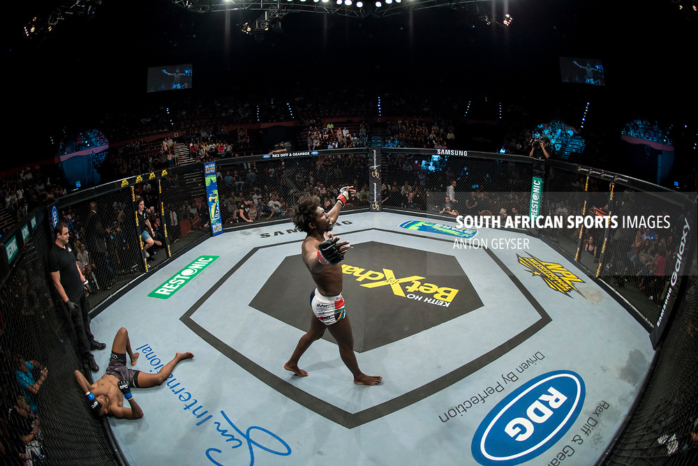JOHANNESBURG, SOUTH AFRICA - NOVEMBER 04:  Regis Muyambo celebrates after defeating Sindile Manengela - Featherweight - during EFC 65 Fight Night at Carnival City on November 04, 2017 in Johannesburg, South Africa. (Photo by Anton Geyser/EFC Worldwide/Gallo Images)