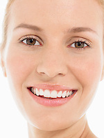 Young blonde Woman Smiling portrait close up