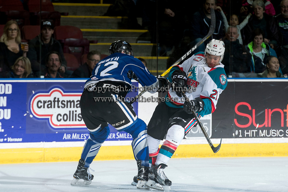 KELOWNA, CANADA - MARCH 11: Spencer Gerth #12 of the Victoria Royals checks Devante Stephens #21 of the Kelowna Rockets on March 11, 2017 at Prospera Place in Kelowna, British Columbia, Canada.  (Photo by Marissa Baecker/Shoot the Breeze)  *** Local Caption ***