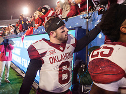 Nov 19, 2016; Morgantown, WV, USA; Oklahoma Sooners quarterback Baker Mayfield (6) celebrates with fans after beating the West Virginia Mountaineers  at Milan Puskar Stadium. Mandatory Credit: Ben Queen-USA TODAY Sports