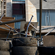 A portrait of Lenin sits atop a barricade surrounding a besieged government building in Donetsk.