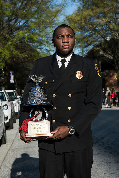 Atlanta, April 4, 2018:  Sgt Cortez R. Stafford of the Atlanta Fire Rescue Department, holds the Chaplain Memorial Bell during the commemoration of the 50th anniversary of the assassination of Rev. Dr. Martin Luther King, Jr.
