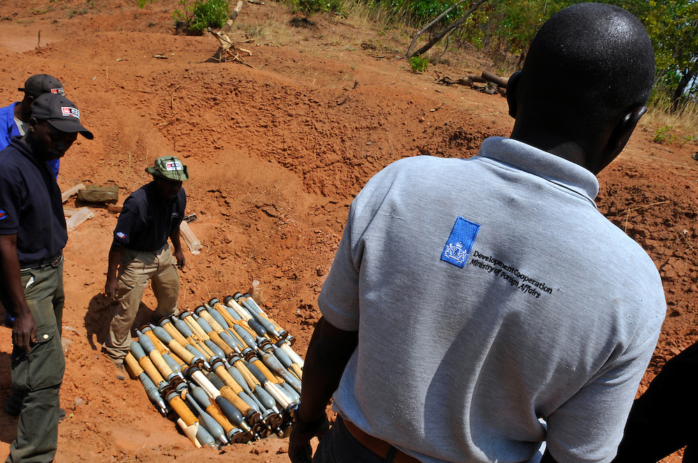 A technical team of deminers from Mines Advisory Group (MAG) preparing a demolition pit for a stockpile of weapons and ammunition recovered by the Angolan police and given to MAG to destroy..Luena, Angola. 30/09/2010..Photo © J.B. Russell