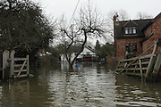 Flooded homes on Friary Island, Wraysbury near Staines. Flood waters remain high after last weeks flooding across the Thames valley. UK<br />