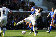 Marouane Fellaini © of Everton battles for the ball with Swansea city's Ki Sung-Yueng.  Barclays Premier league, Swansea city v Everton at the Liberty stadium in Swansea, South Wales on Sat 22nd Sept 2012.   pic by  Andrew Orchard, Andrew Orchard sports photography,