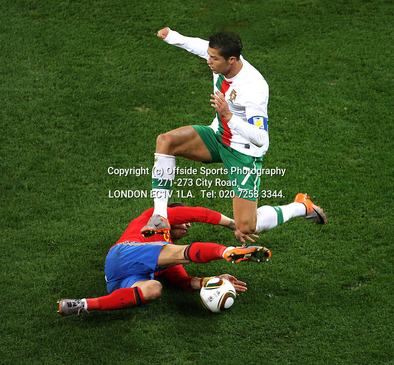 29/06/2010 World Cup. Spain v Portugal.<br /> Cristiano Ronaldo is tackled by Sergio Ramos.<br /> Photo: Mark Leech.