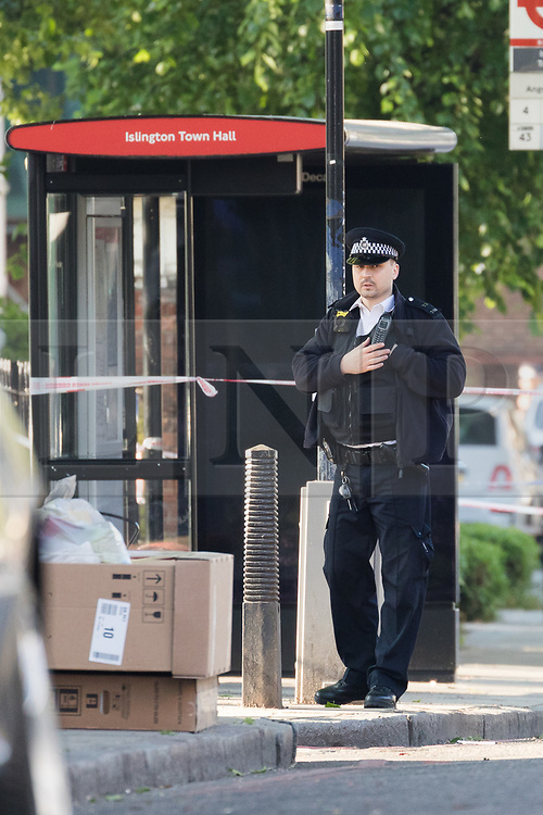 © Licensed to London News Pictures. 22/05/2018. London, UK. Police at the crime scene cordon in Upper Street, Islington this morning. Police were called at approximately 18:30hrs on Monday, 21 May to reports of a man suffering stab injuries after being attacked in Upper Street.<br /> Officers and London Ambulance Service attended. The man was pronounced dead at the scene. Photo credit: Vickie Flores/LNP
