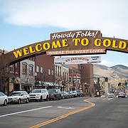 A sign arches over the main street of Golden, Colorado, welcoming visitors to the town.