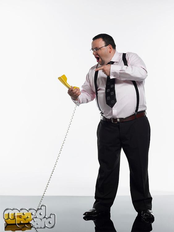 Businessman yelling at phone