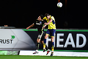 Oxford United defender Aaron Martin (6) heads the ball under pressure during the EFL Trophy match between Oxford United and Brighton and Hove Albion at the Kassam Stadium, Oxford, England on 3 October 2017. Photo by Dennis Goodwin.